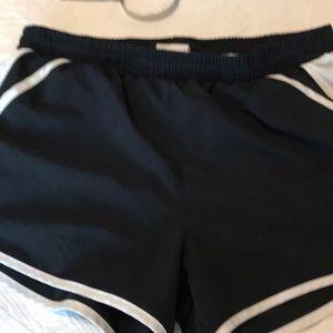 Under Armour running shorts.